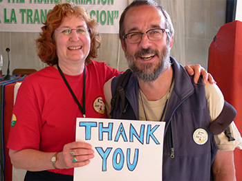 Two people holding 'Thank You' sign